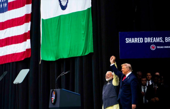 Image for At Rally for India's Modi, Trump Plays Second Fiddle but a Familiar Tune