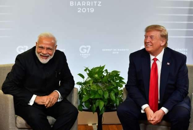 Image for Agence France-Presse: In show of bond, Trump to join Modi in mass Houston rally
